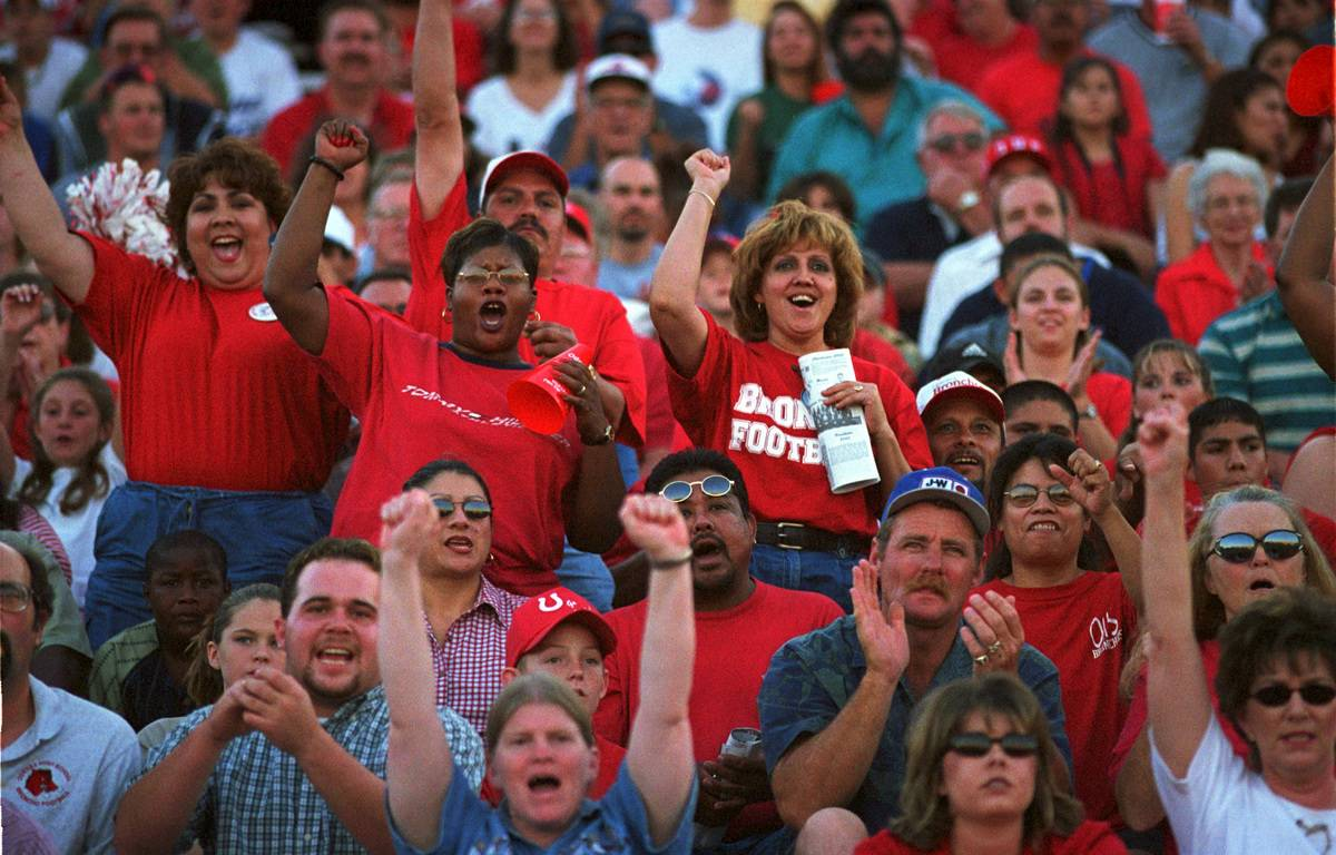 People cheer during a football game.