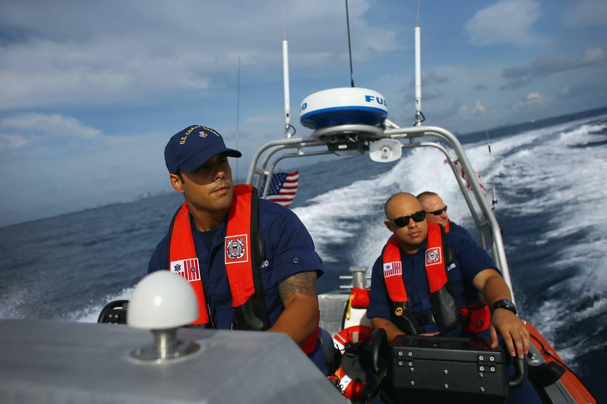 Members of the Miami Coast Guard sail across the ocean.