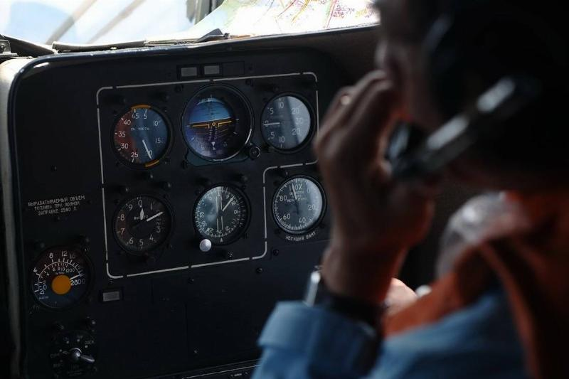 A pilot controls the cockpit of a MI-171 helicopter.