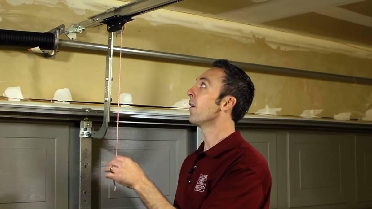 A YouTuber demonstrates how to unplug the garage door opener