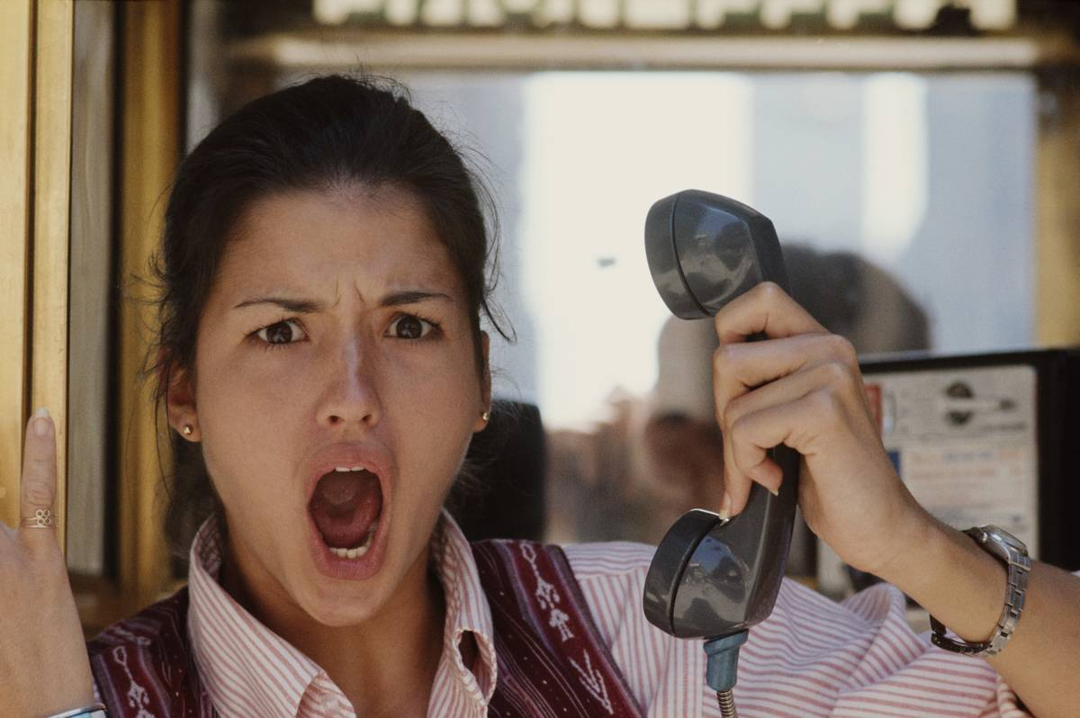 A model appears offended when she talks on the phone.