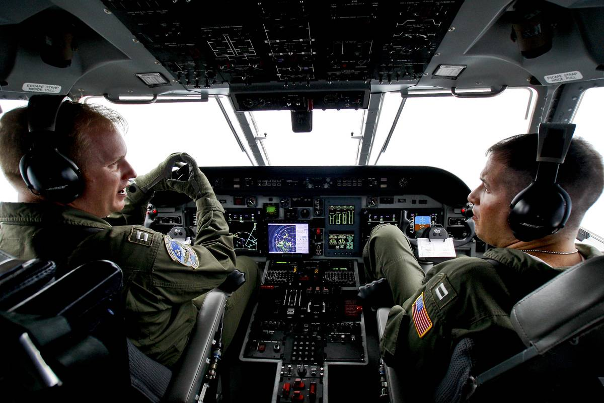 Coast Guard pilots are talking to each other in a helicopter.