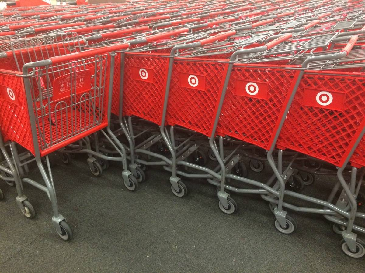 Shopping carts are stacked in front of a Target.