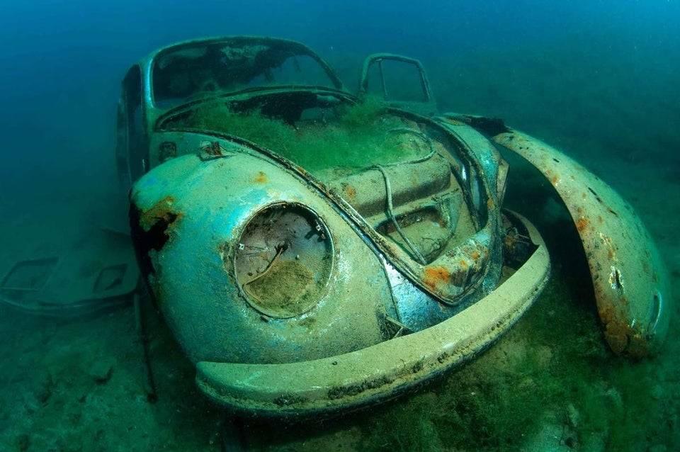 A Volkswagen Beetle is seen underwater.