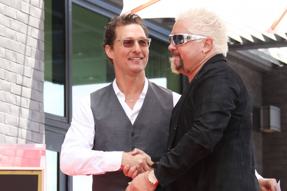 Actor Matthew McConaughey and Guy Fieri attend the ceremony to honor Guy Fieri with a Star on the Hollywood Walk of Fame.
