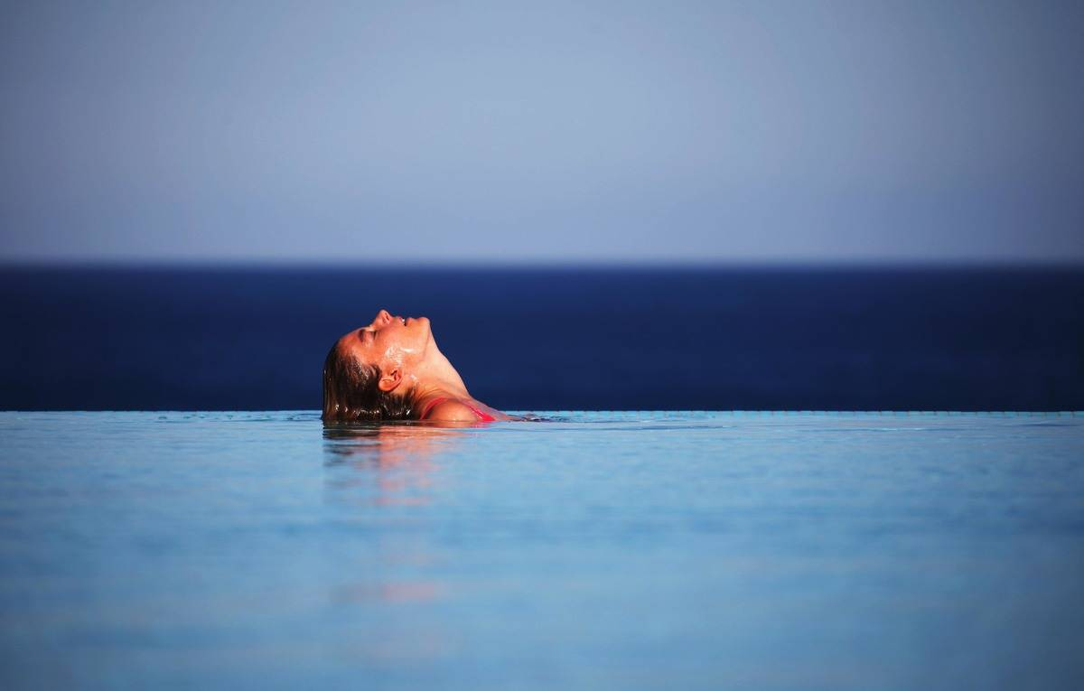 A woman is in a swimming pool in Rhodes, Greece.