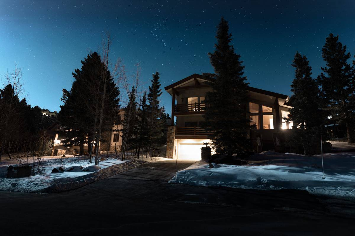 exterior shot of a house with the lights on inside