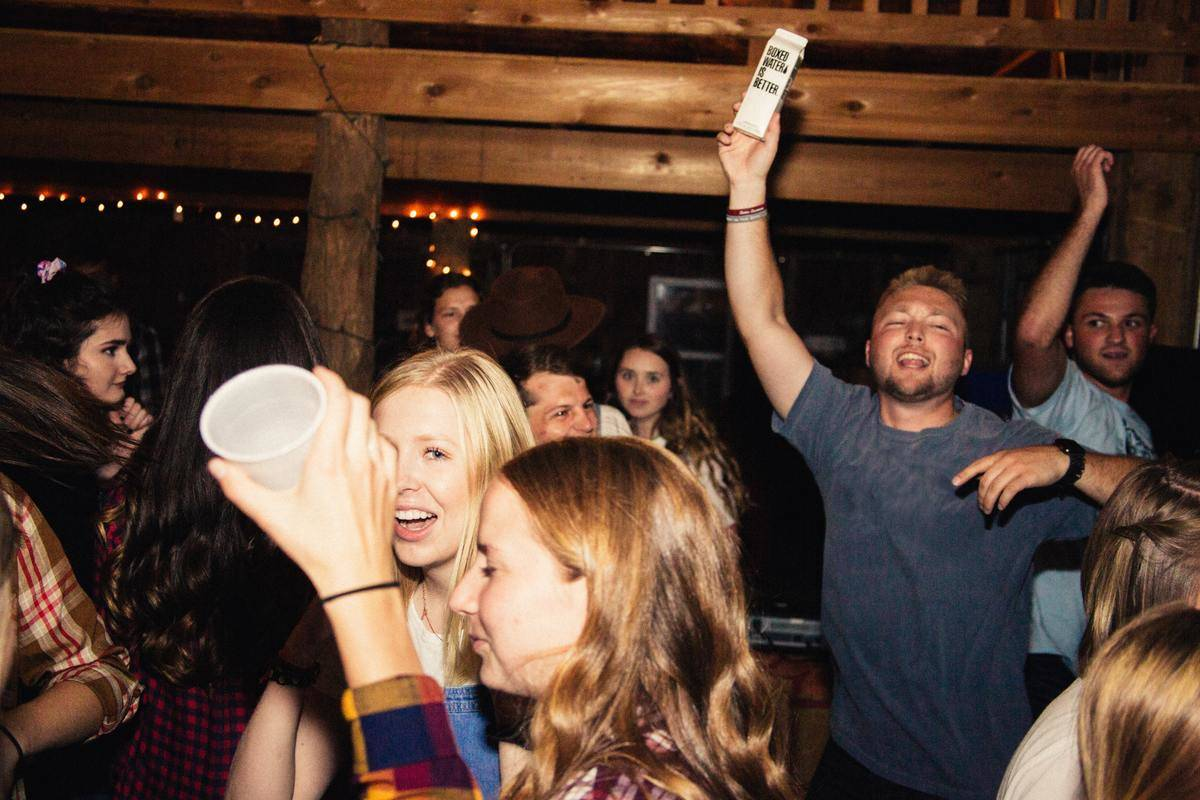a house party at night with teens