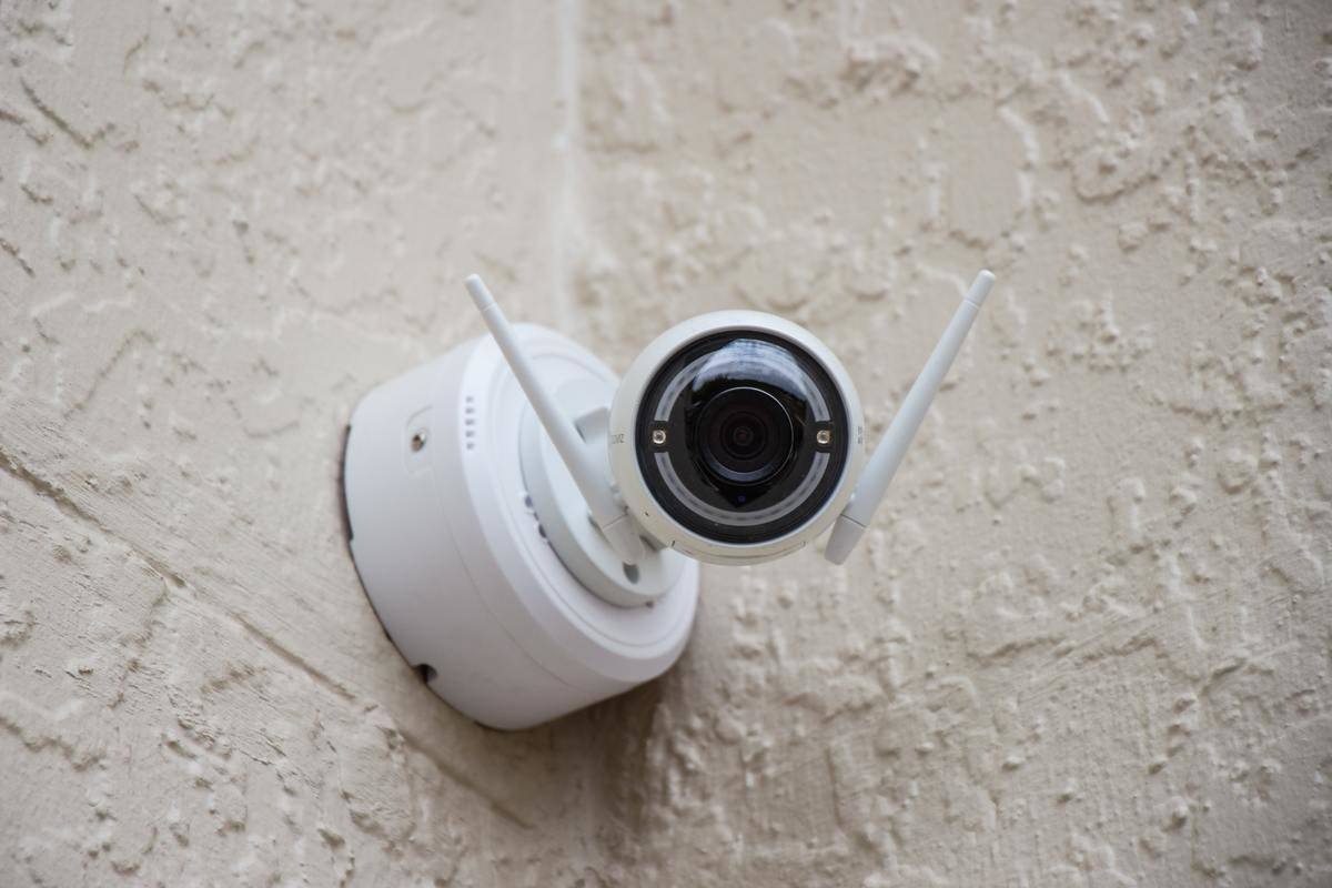 security camera mounted on a wall outside