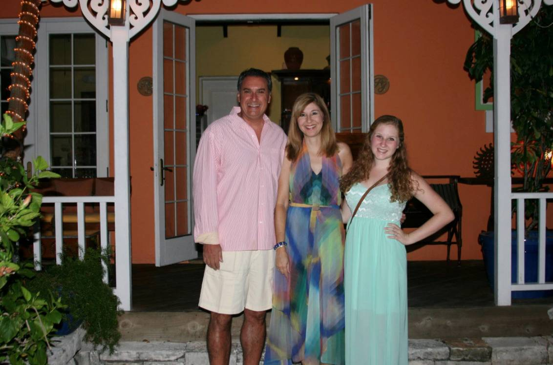 The Cartellone family poses for a photo in front of a restaurant.