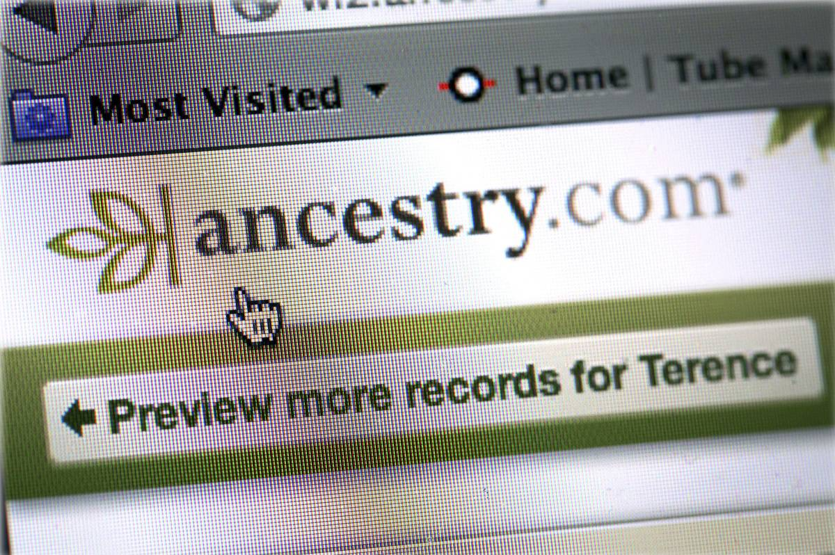 A woman checks her ancestry connections on her iPad on ancestry.com.