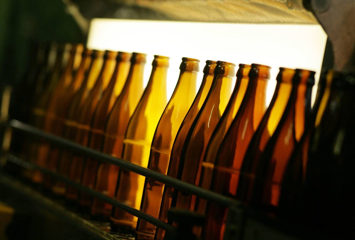 Empty beer bottles are displayed at a brewery.
