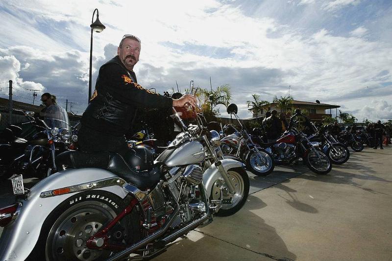 a Bandidos club member parking his motorcycle