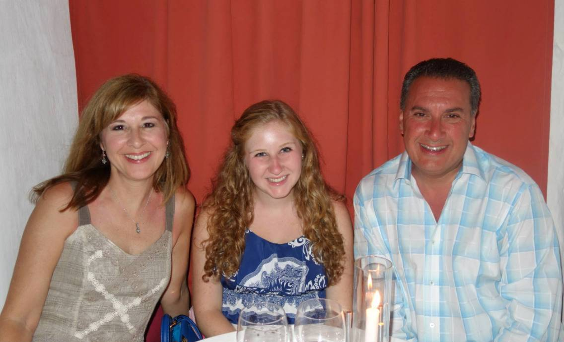 The Cartellone family is photographed during a dinner at a restaurant.