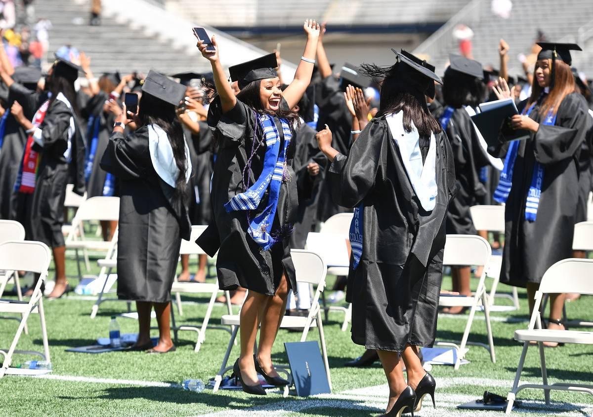 University students celebrate graduating college in Atlanta, Georgia.
