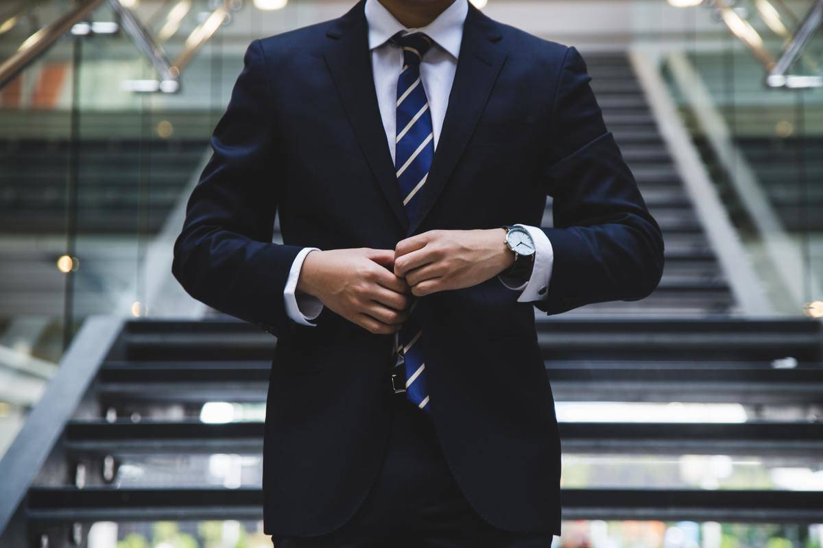 A male lawyer is seen in a suit.