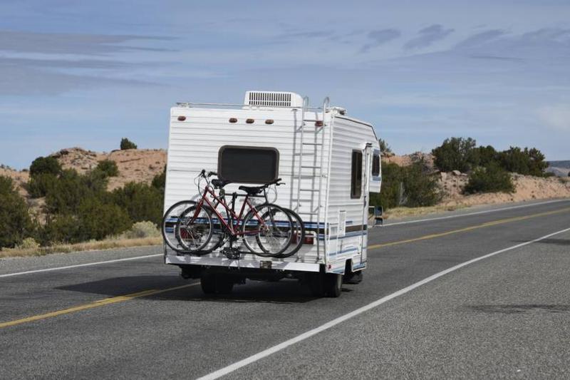 A mobile home drives through New Mexico.