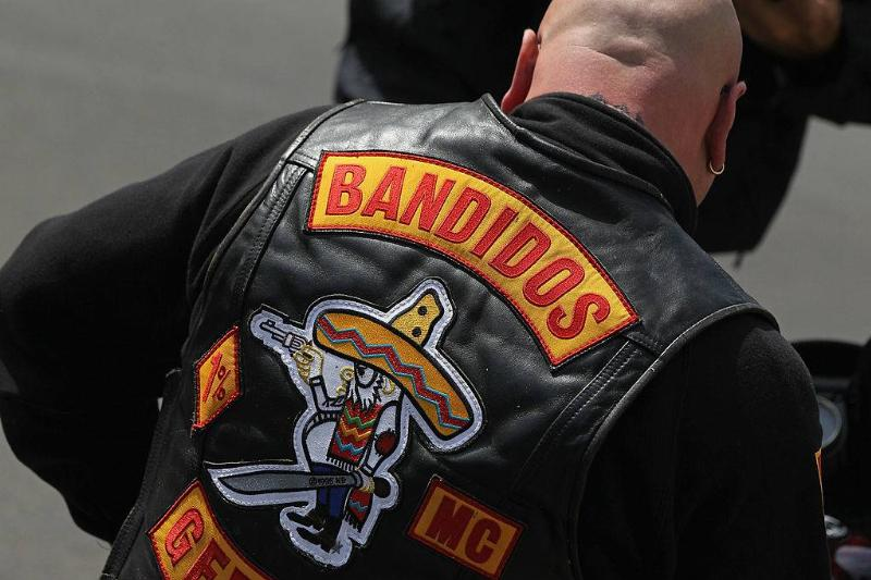 A member of the Bandidos motorcycle gang sits on his motorcycle
