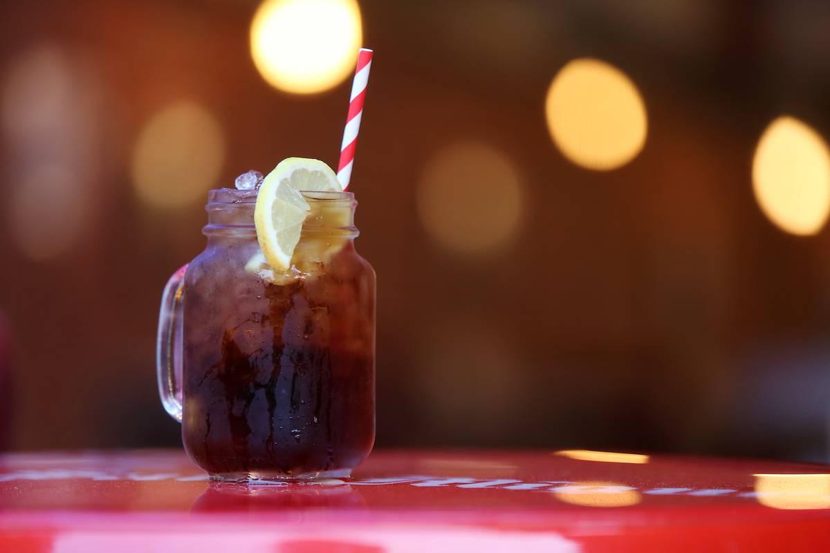 Texas sweet iced tea is in a mason jar with a straw.