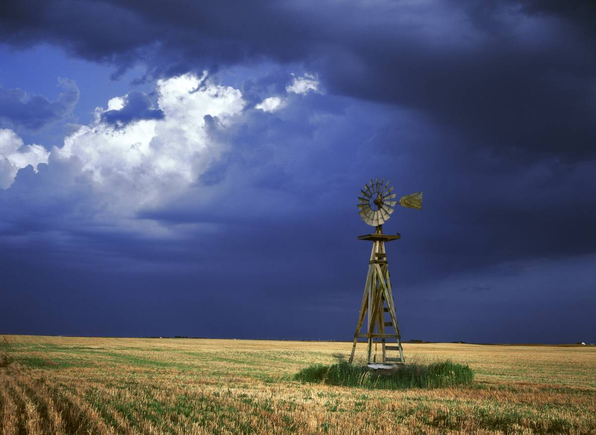 A lone windmill stands on a farm in Kansas.