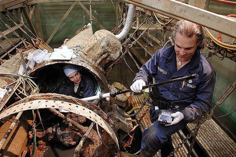 soldiers working on a submarine