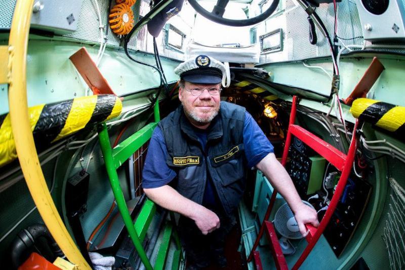 a man aboard a submarine