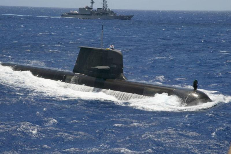 submarine partially submerged in the ocean