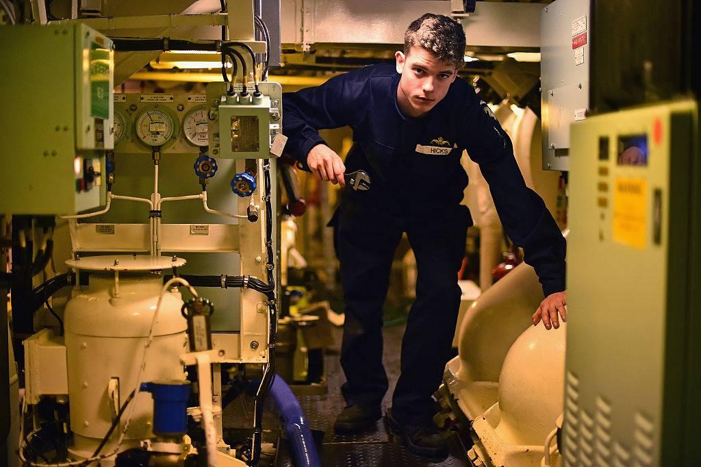 soldier working on a submarine