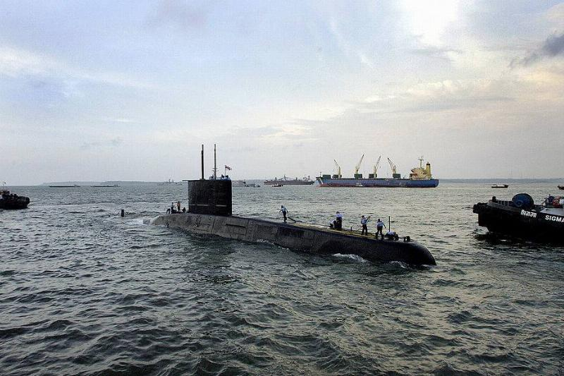 a submarine partially submerged in the water