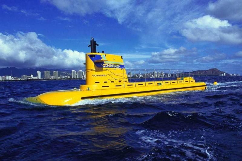 a yellow submarine above the water