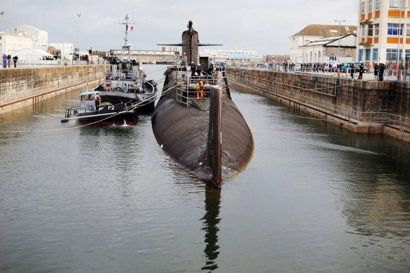 submarine partially submerged in the water
