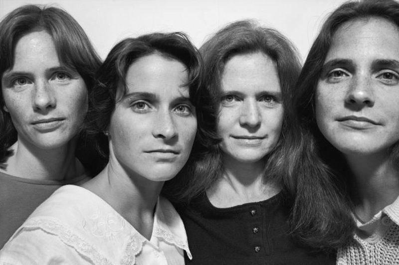 four sisters in a photo booth 1986