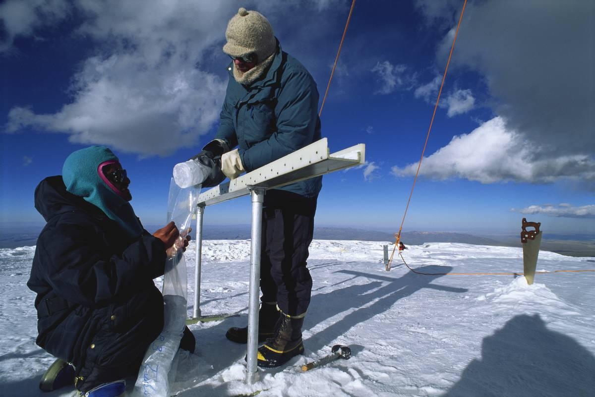 Glaciologists taking ice core samples on Nevado Sajama
