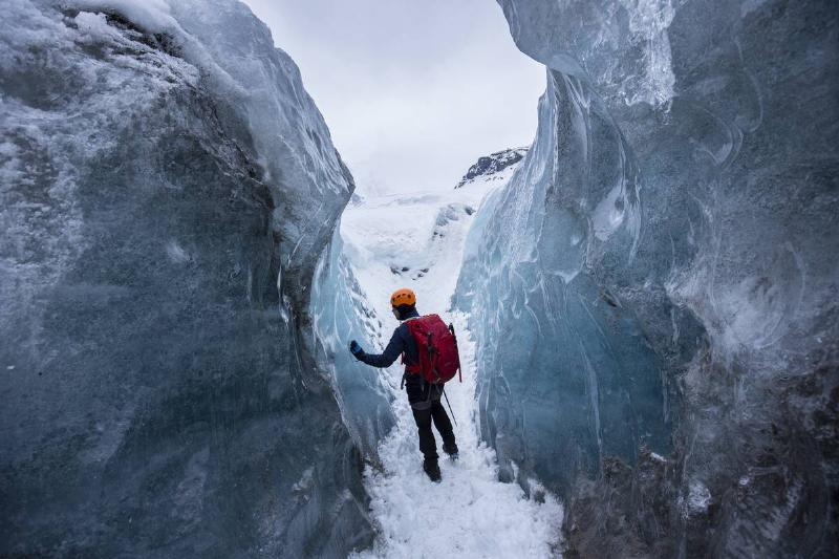 Tourist on Svinafellsjokull Glacier in Iceland