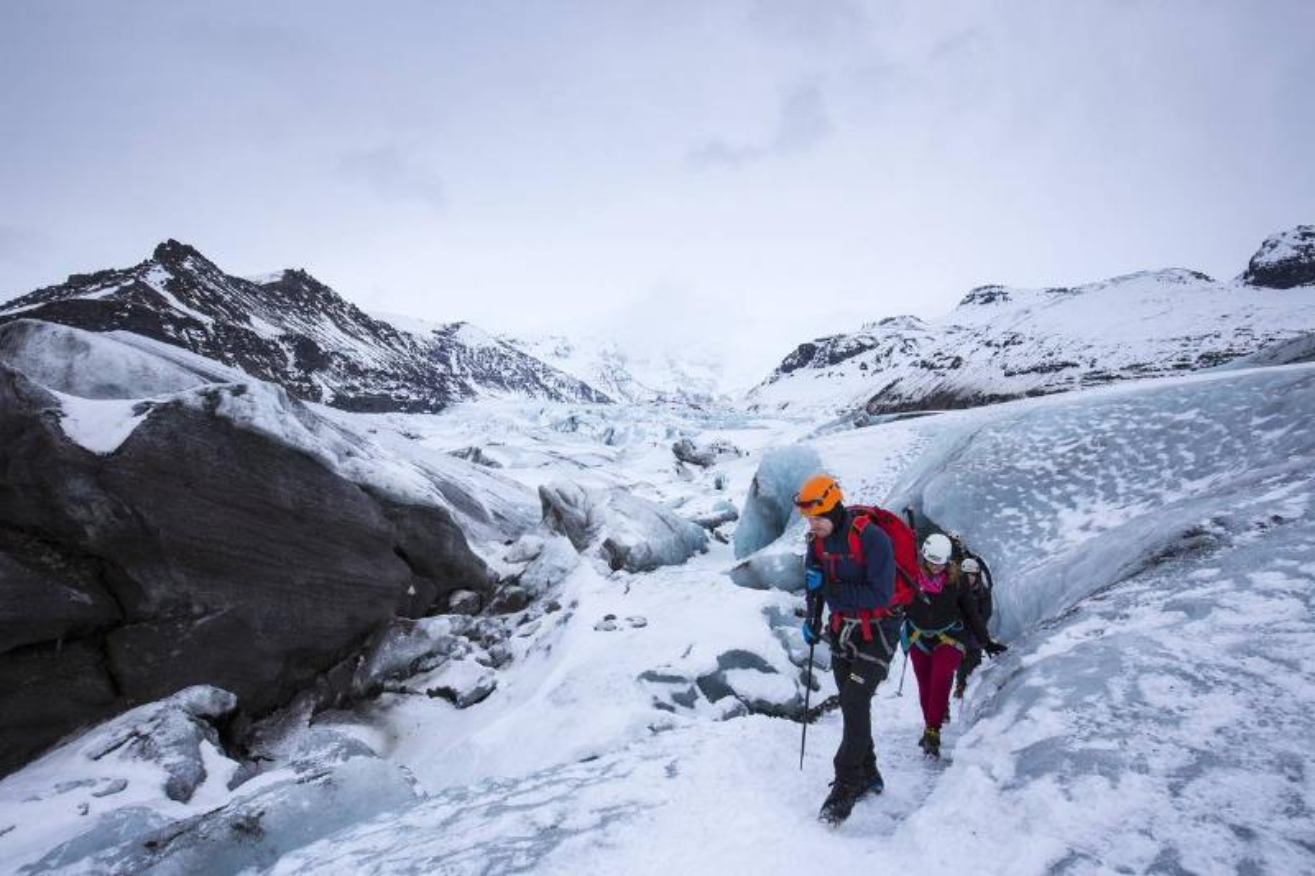 Tourists on Svinafellsjokull Glacier in Iceland
