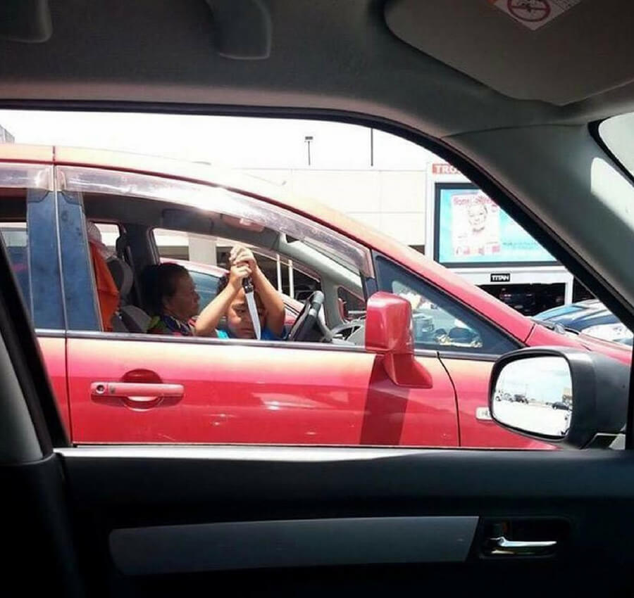 kid with knife in car.jpg