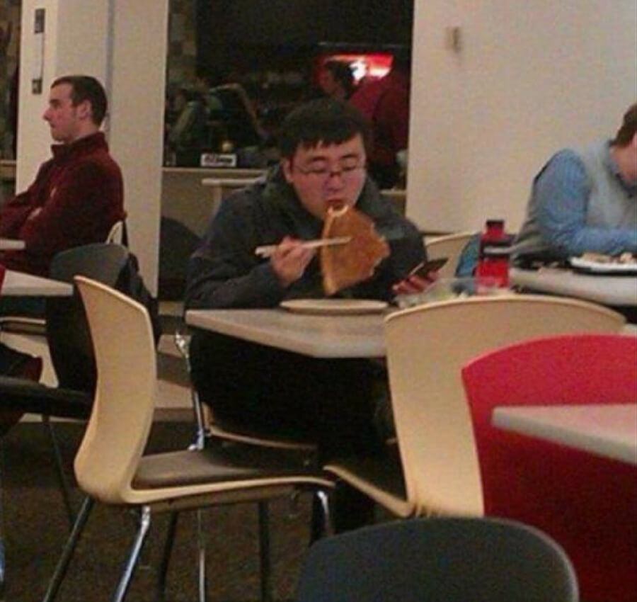 eating pizza with chopsticks.jpg