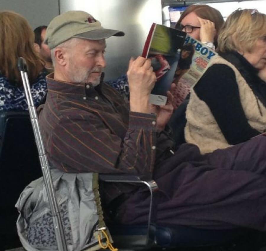 man reading magazine in airport.jpg